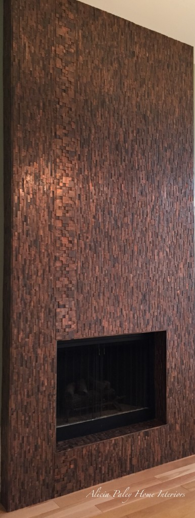 Copper floor to ceiling fireplace